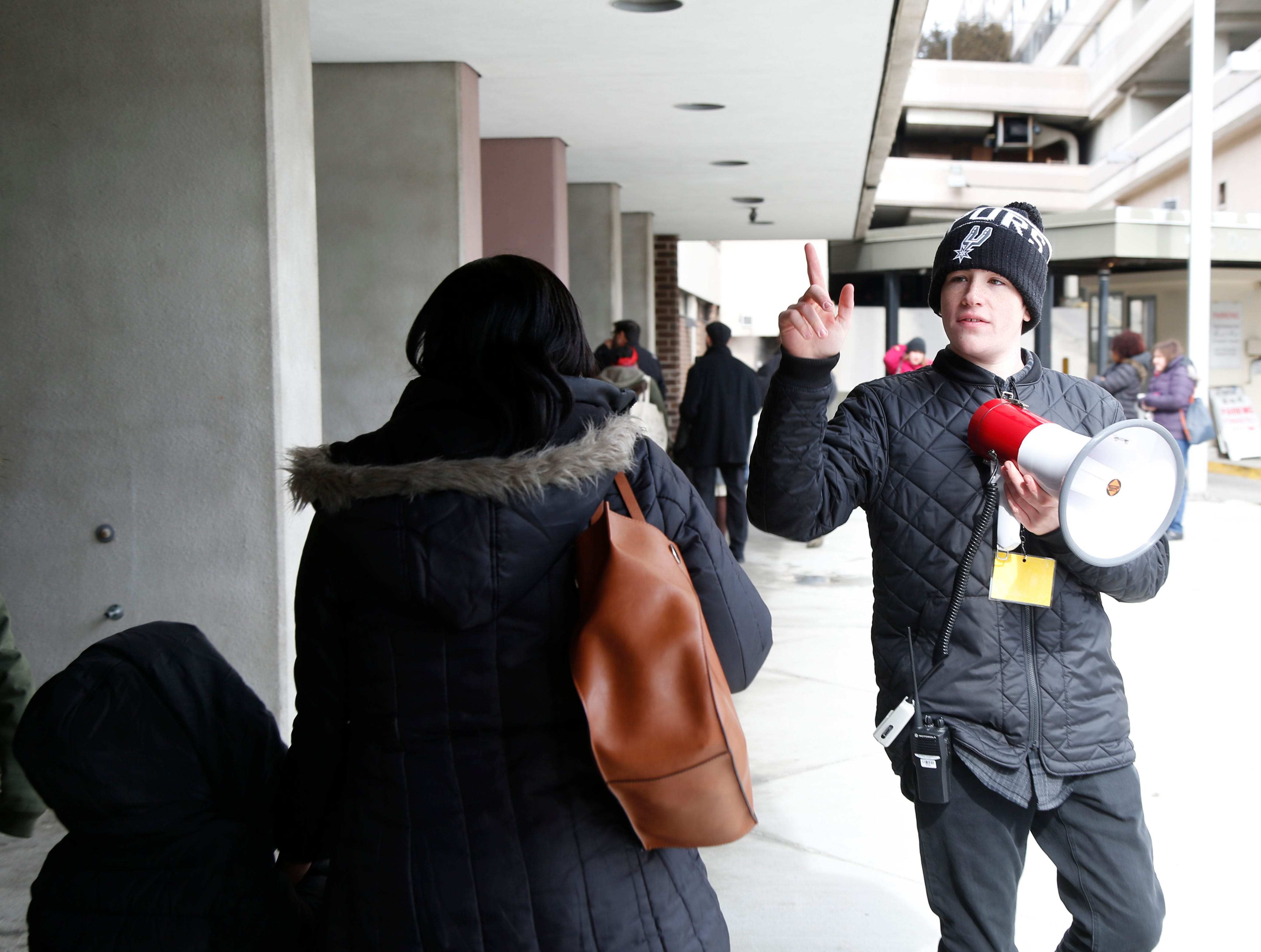 """Dylan Powers from Rita Powers Casting makes announcements outside the Majed J. Nesheiwat Convention Center for Saturday's open casting call for an HBO series staring Mark Ruffalo, called """"I Know This Much is True"""" in the City of Poughkeepsie on Feb 23, 2019."""