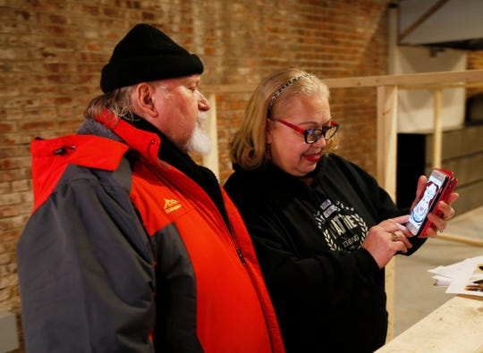 "Erich and Hattie Hess review the logo for their food booth, ""Miz Hatties"" at the Hudson Valley Food Hall in Beacon on February 20, 2019. Miz Hatties will feature authentic southern barbecue."