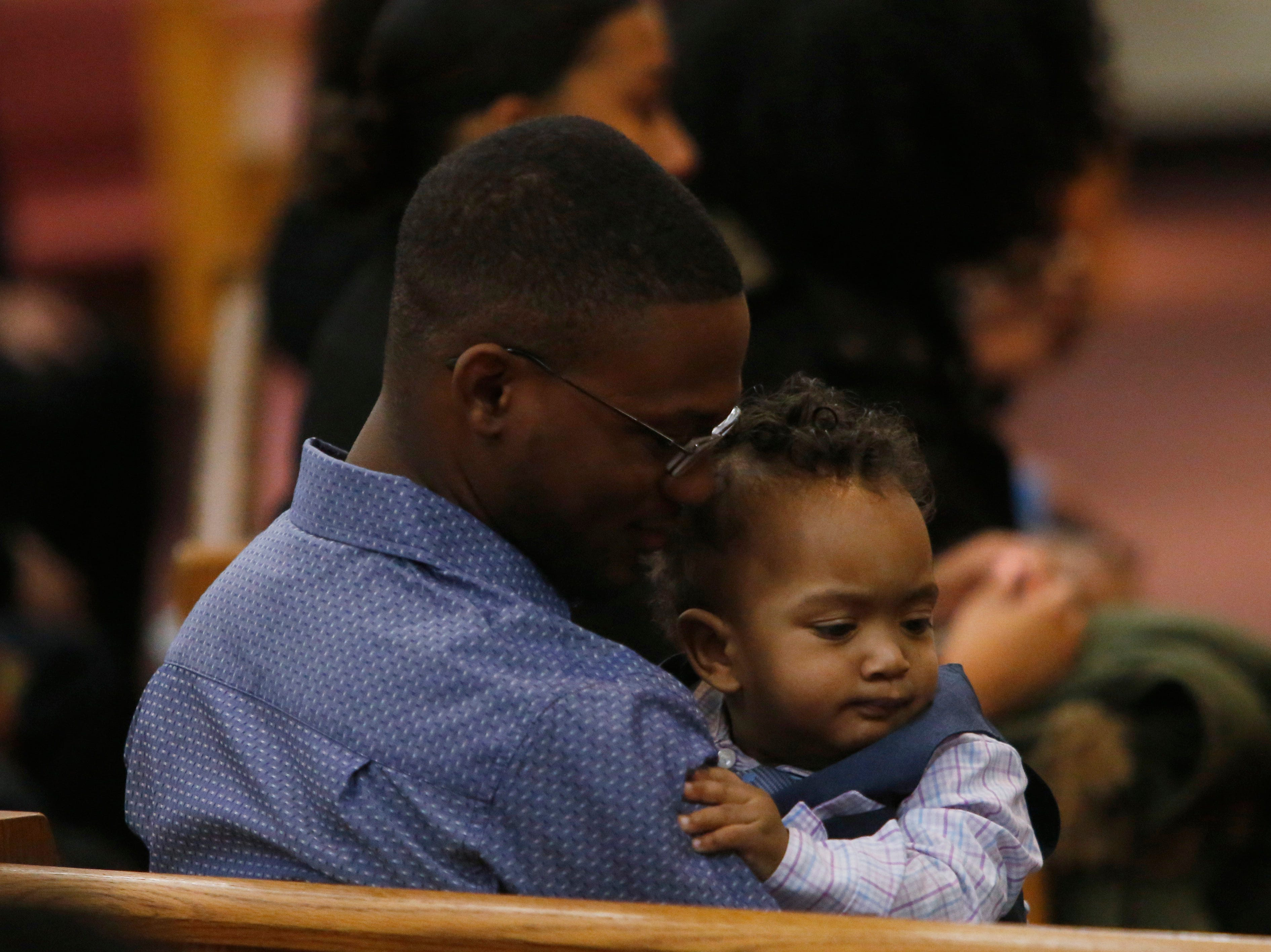 Jaquan Cesar's brother, Jordan Cesar holds Jaquan's son, Yasir, during Jaquan's funeral service at Beulah Baptist Church in the City of Poughkeepsie on February 22, 2019. Jaquan died on Feb 11th while attempting to help a stranded motorist on the Cross Bronx Expressway.
