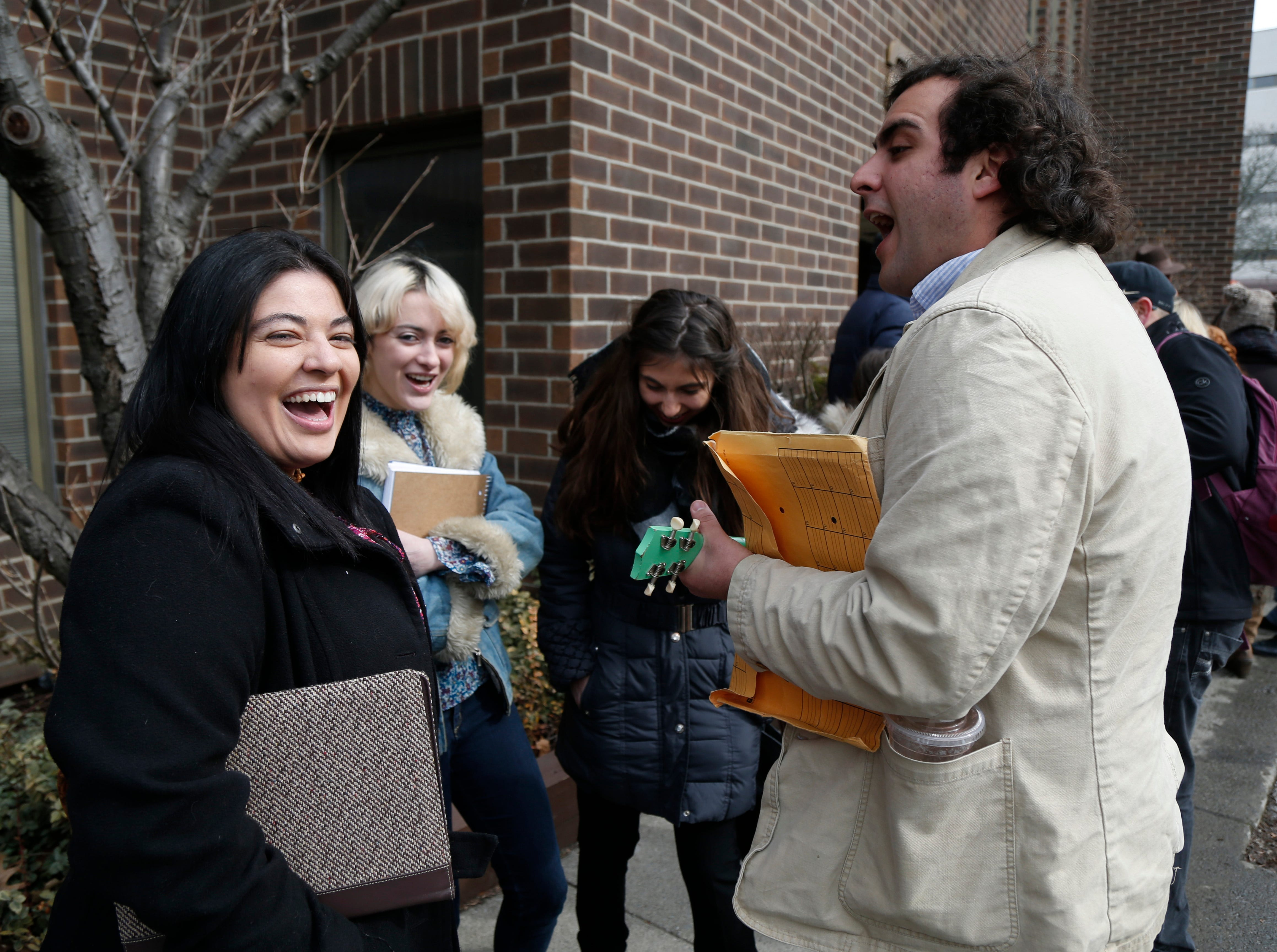 """From left, Jamie Arcelay of Poughkeepsie, Kiley Ronyé of Rosendale, and SUNY New Paltz students Jamie Lazan & Joseph David sing songs while waiting on line outside the Majed J. Nesheiwat Convention Center for Saturday's open casting call for an HBO series staring Mark Ruffalo, called """"I Know This Much is True"""" in the City of Poughkeepsie on Feb 23, 2019."""