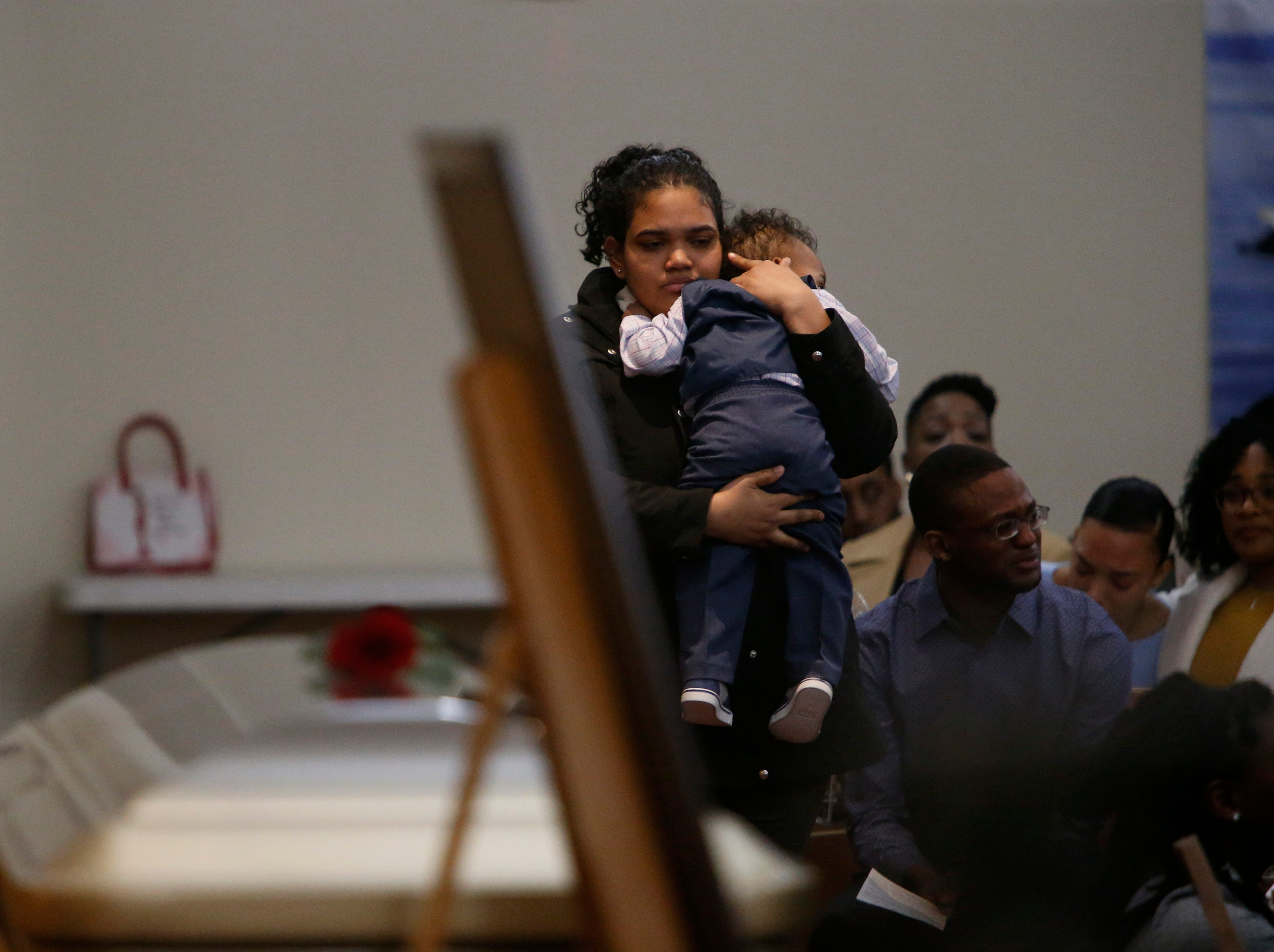 Jaquan Cesar's girlfriend, Edwina Cepeda Aracena holds their son, Yasir Cesar during the funeral service for Jaquan at Beulah Baptist Church in the City of Poughkeepsie on February 22, 2019. Jaquan died on Feb 11th while attempting to help a stranded motorist on the Cross Bronx Expressway.