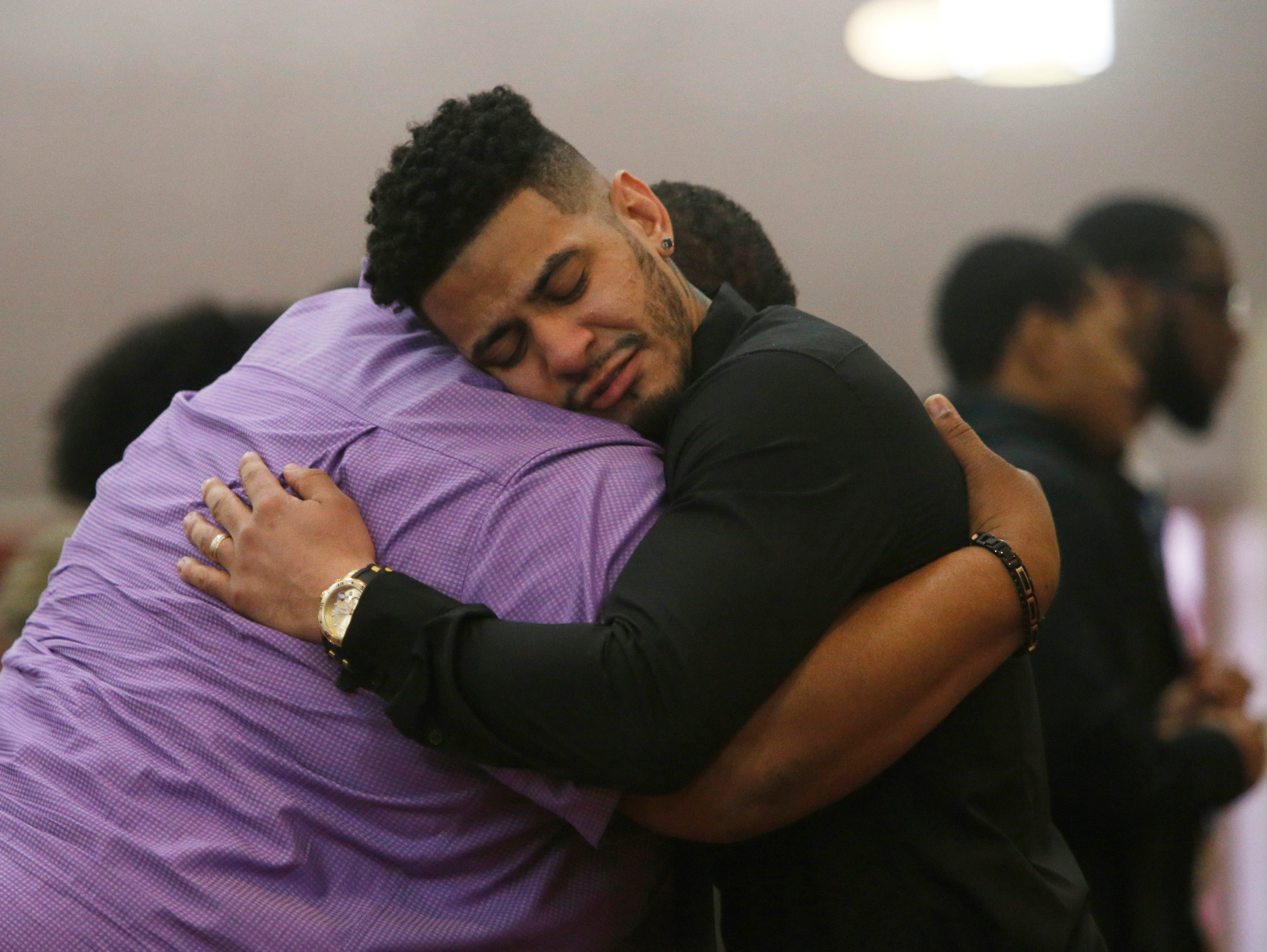 Terrance Parson embraces Georges Cesar, during Friday's funeral service forJaquan Cesar on February 22, 2019. Jaquan died on Feb 11th while attempting to help a stranded motorist on the Cross Bronx Expressway.