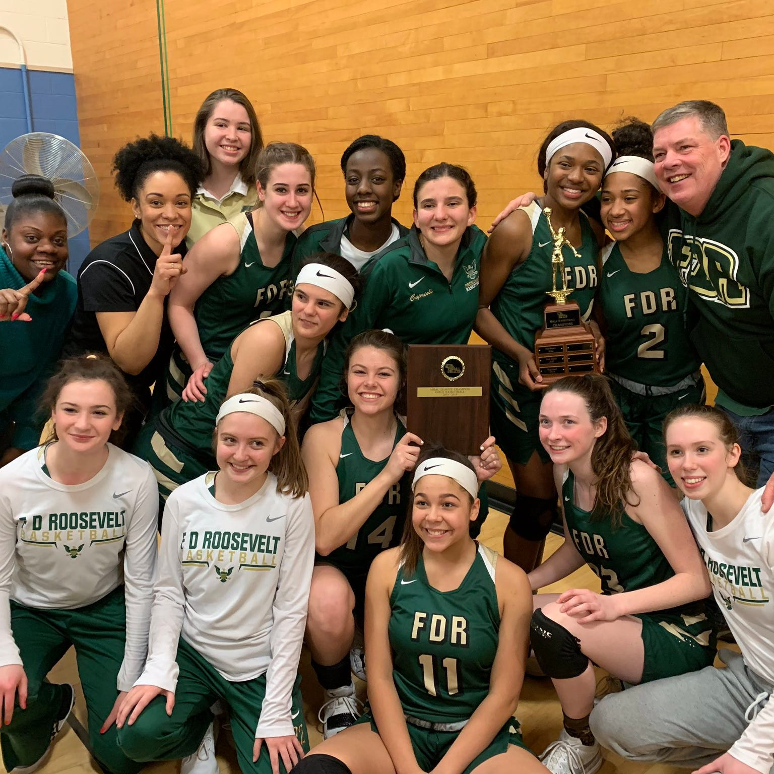 The Franklin D. Roosevelt girls basketball team poses after winning its first Mid-Hudson Athletic League title on Friday.