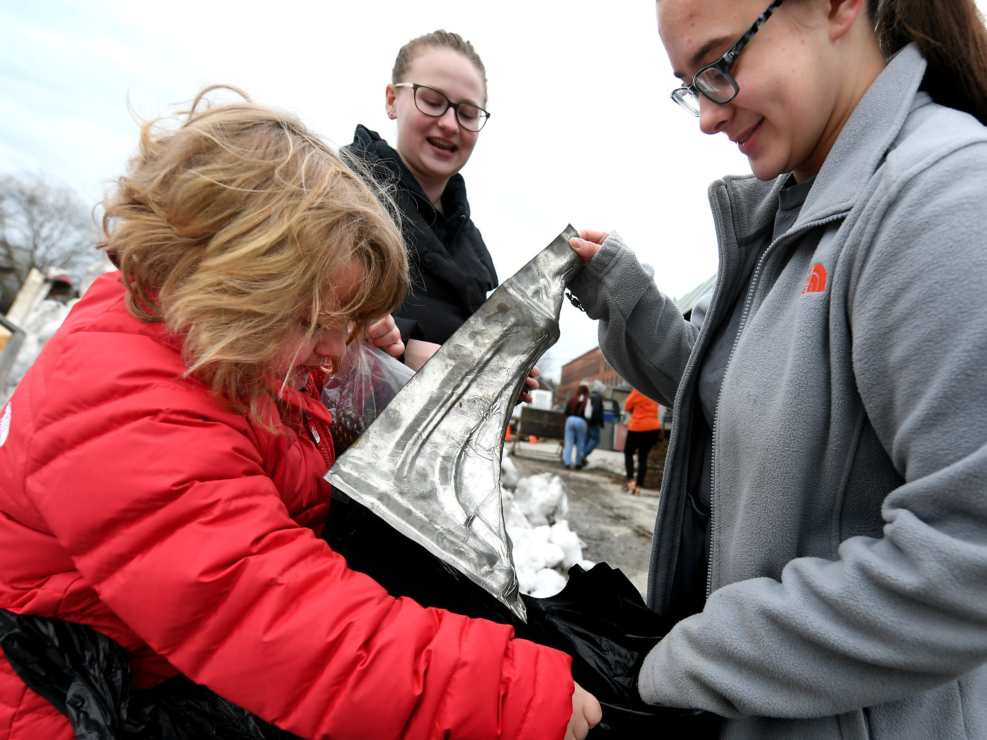 Central High School sophomores Lea Wilhelm, center, Emma Crumling and Lea's sister Brynlee Dietrich, left, collect items for the sophomore's entry in the York County Solid Waste Authority Recycled Art Contest during Picker Dayat the architectural salvage warehouse Refindings in York City Saturday, Feb. 23, 2019. The waste authority is sponsoring the fifth annual contest for York County high school students to promote recycling and celebrate Earth Day. Students create sculptures by mid-April from the materials donated by Refindings and the contest exhibit will be on display in the Marketview Arts Gallery, 37 W. Philadelphia St., beginning Sunday, April 14. Contest winners will be announced there during an awards event April 18. Bill Kalina photos