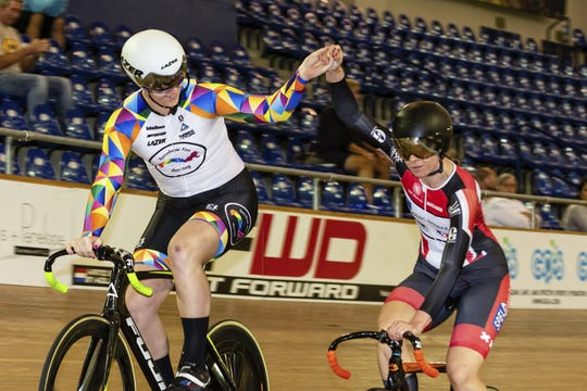 In this Oct. 13, 2018 photo provided by Craig Huffman, transgender cyclist Rachel McKinnon of Canada, left, holds hands with competitor Carolien Van Herrikhuyzen of the Netherlands during the UCI Masters Track Cycling World Championships in Carson, Calif. Initially, McKinnon was elated with her win, even though one of her top rivals pulled out of the final at the last minute. But there quickly was a downside to the victory, as a photo gained attention across the internet showing her on the podium with the two smaller, skinnier runners-up.