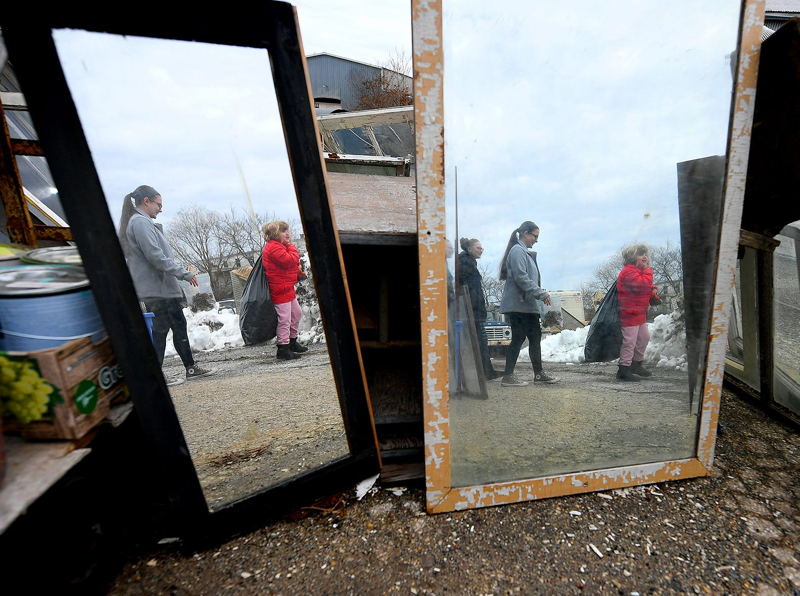Central High School sophomores, from left, Lea Wilhelm, Emma Crumling and Lea's sister Brynlee Dietrich are reflected in vintage mirrors while choosing items for the sophomore entry in the York County Solid Waste Authority Recycled Art Contest during Picker Day at the architectural salvage warehouse Refindings in York City Saturday, Feb. 23, 2019. The waste authority is sponsoring the fifth annual contest for York County high school students to promote recycling and celebrate Earth Day. Students create sculptures by mid-April from the materials donated by Refindings and the contest exhibit will be on display in the Marketview Arts Gallery, 37 W. Philadelphia St., beginning Sunday, April 14. Contest winners will be announced there during an awards event April 18. Bill Kalina photos