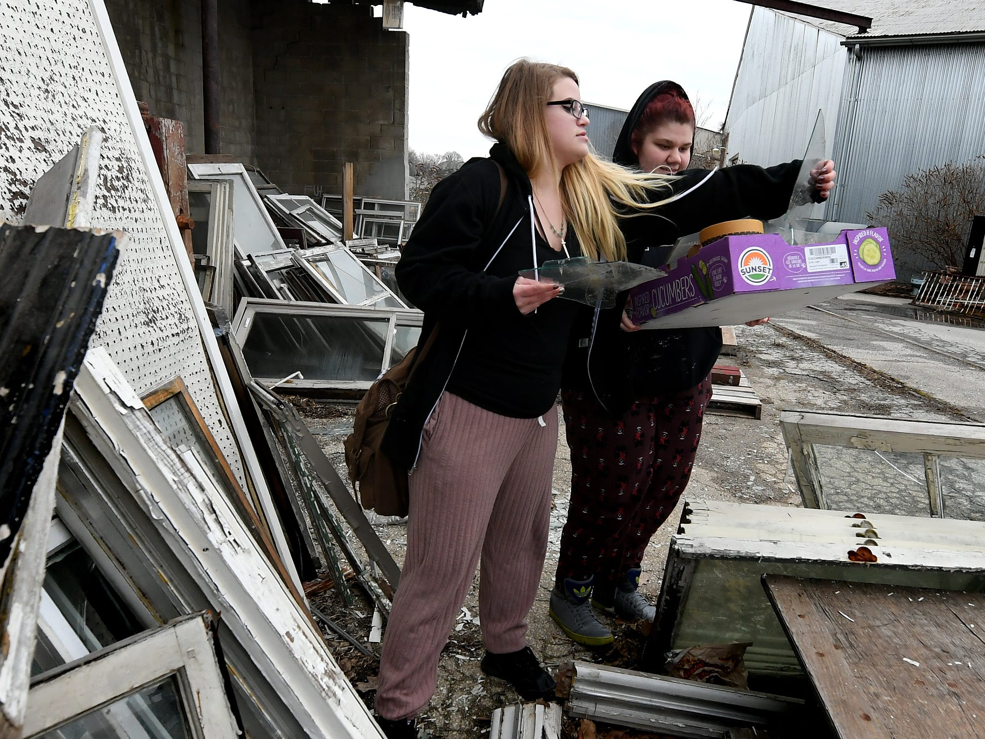Red Land High School seniors Rebecca Waller and Mackenzie Burns, right, collect glass while choosing items for their entry in the York County Solid Waste Authority Recycled Art Contest during Picker Day at the architectural salvage warehouse Refindings in York City Saturday, Feb. 23, 2019. The waste authority is sponsoring the fifth annual contest for York County high school students to promote recycling and celebrate Earth Day. Students create sculptures by mid-April from the materials donated by Refindings and the contest exhibit will be on display in the Marketview Arts Gallery, 37 W. Philadelphia St., beginning Sunday, April 14. Contest winners will be announced there during an awards event April 18. Bill Kalina photo