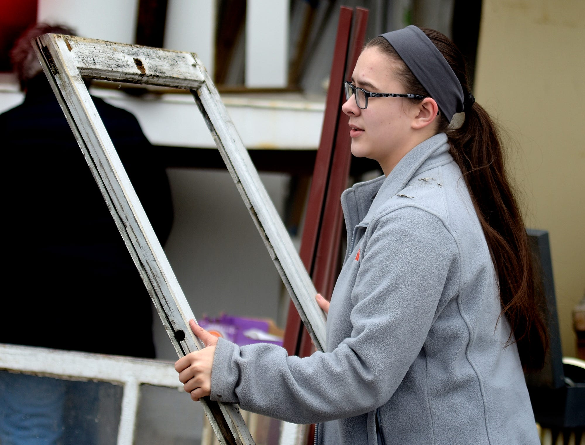 Central High School sophomore Emma Crumling considers a window frame while choosing items for her entry in the York County Solid Waste Authority Recycled Art Contest during Picker Day at the architectural salvage warehouse Refindings in York City Saturday, Feb. 23, 2019. The waste authority is sponsoring the fifth annual contest for York County high school students to promote recycling and celebrate Earth Day. Students create sculptures by mid-April from the materials donated by Refindings and the contest exhibit will be on display in the Marketview Arts Gallery, 37 W. Philadelphia St., beginning Sunday, April 14. Contest winners will be announced there during an awards event April 18. Bill Kalina photo