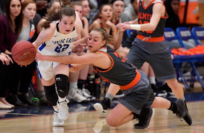 Ella Kale of Spring Grove gets a key steal from Palmyra's Zoe Smith in the final seconds of the District 3 Class 5-A basketball quarterfinal, Friday, February 22, 2019. John A. Pavoncello photo