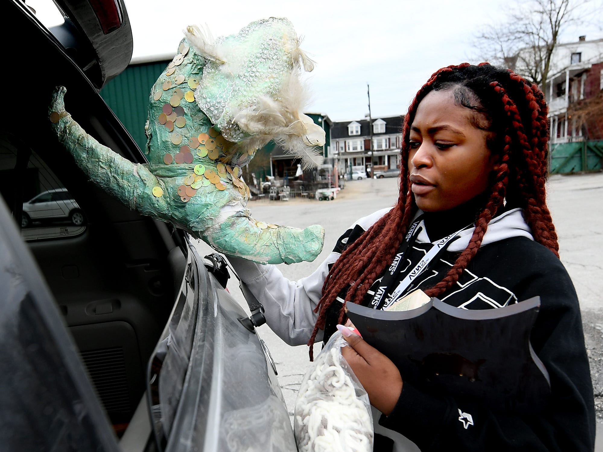 Red Lion High School senior Ranellesa Zizi loads items for her entry in the York County Solid Waste Authority Recycled Art Contest during Picker Day at the architectural salvage warehouse Refindings in York City Saturday, Feb. 23, 2019. The waste authority is sponsoring the fifth annual contest for York County high school students to promote recycling and celebrate Earth Day. Students create sculptures by mid-April from the materials donated by Refindings and the contest exhibit will be on display in the Marketview Arts Gallery, 37 W. Philadelphia St., beginning Sunday, April 14. Contest winners will be announced there during an awards event April 18. Bill Kalina photo