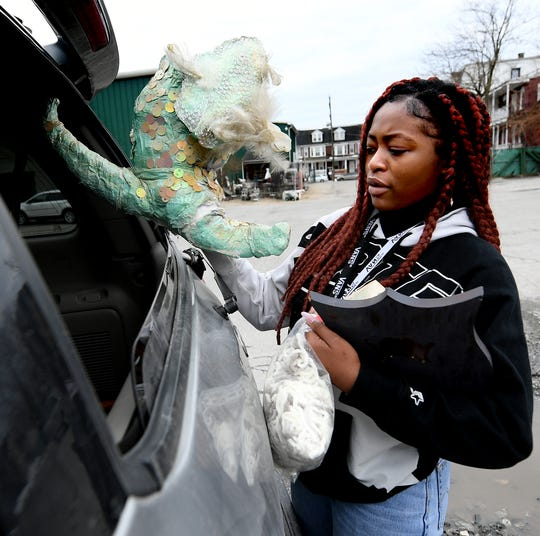 Red Lion High School senior Ranellesa Zizi loads items for her entry in the York County Solid Waste Authority Recycled Art Contest during Picker Day at the architectural salvage warehouse Refindings in York City Saturday, Feb. 23, 2019. Bill Kalina photo