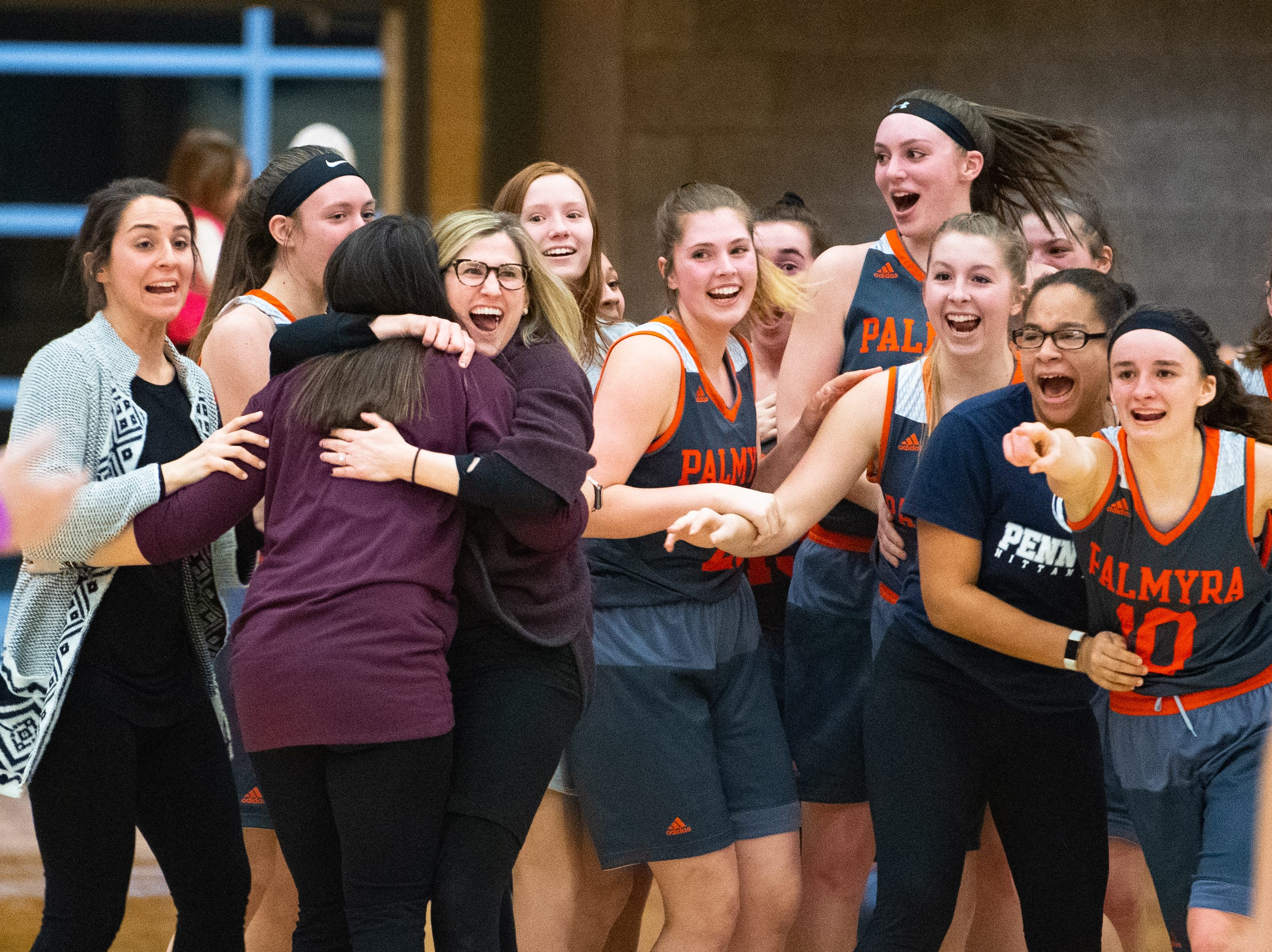 The Cougars celebrate their win after scoring a buzzer beater layup during the District 3 Class 5A girls' basketball quarterfinal between Spring Grove and Palmyra, Friday, February 22, 2019 at Spring Grove Area High School. The Cougars defeated the Rockets 43 to 41.
