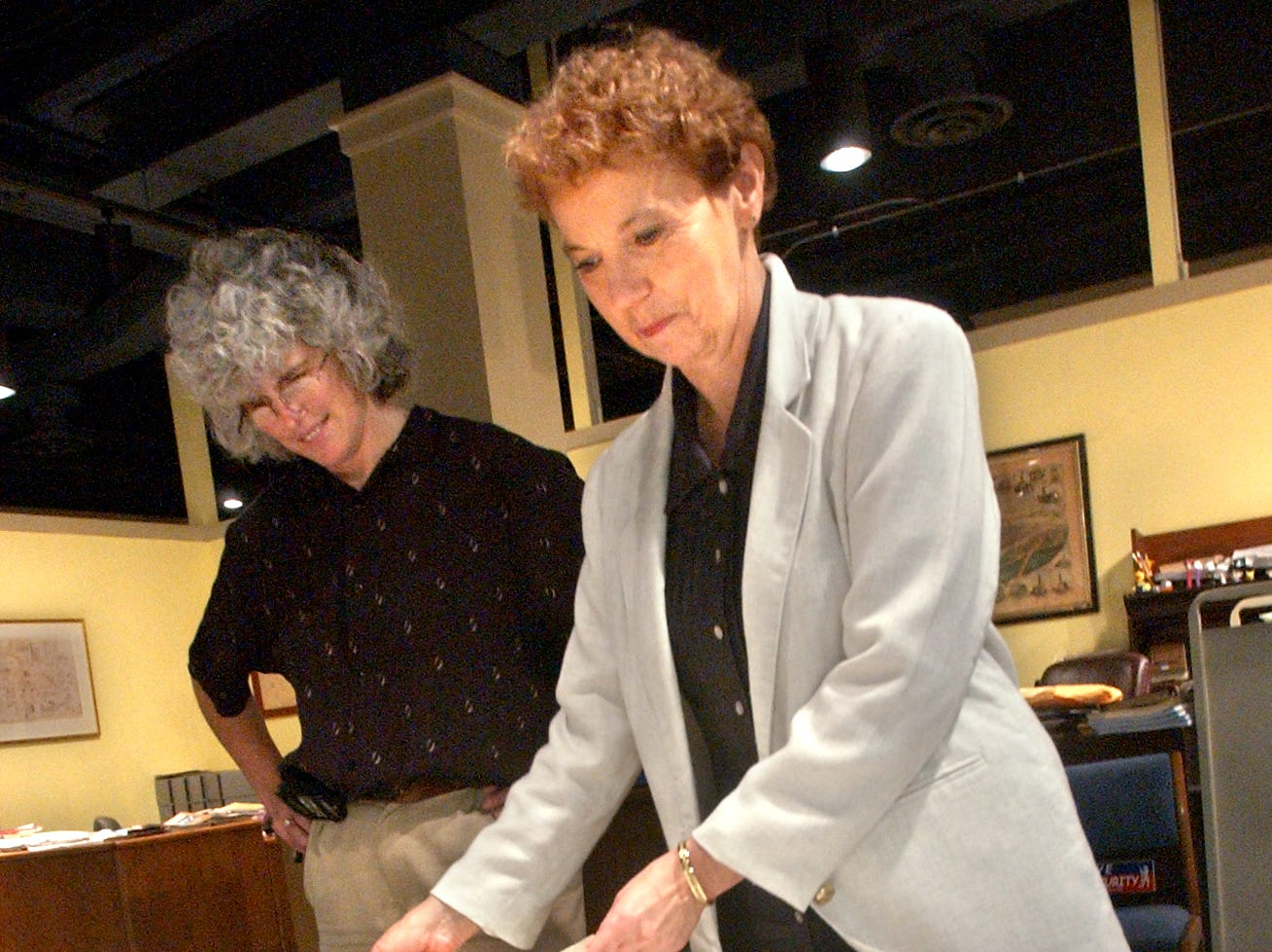 June Lloyd, right, the librarian and archivist with York County Heritage Trust, looks over a document with assistant librarian Lila Fourhman-Shaull in this 2005 file photo.