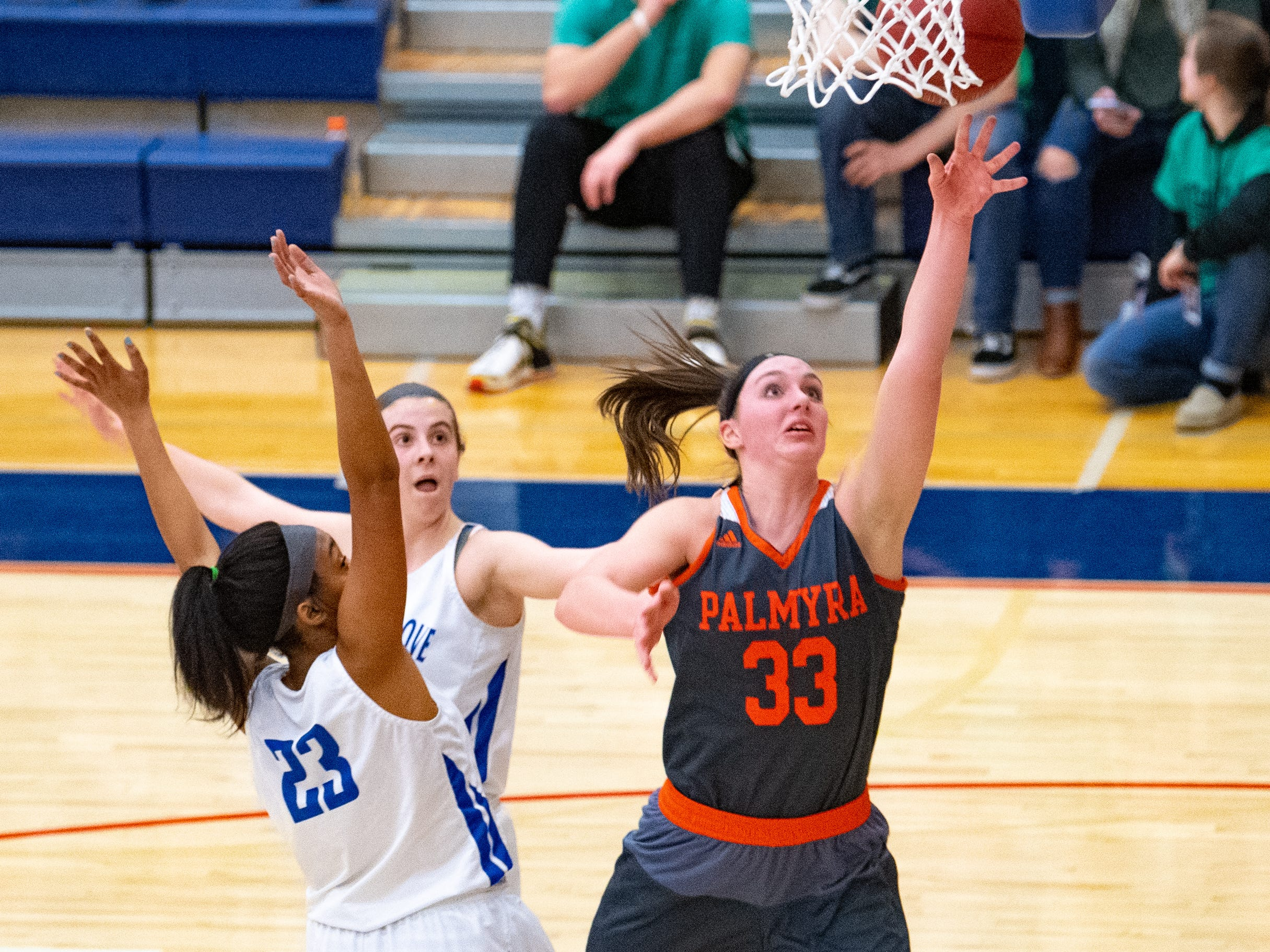 Olivia Richardson (33) scores during the District 3 Class 5A girls' basketball quarterfinal between Spring Grove and Palmyra, Friday, February 22, 2019 at Spring Grove Area High School. The Cougars defeated the Rockets 43 to 41.