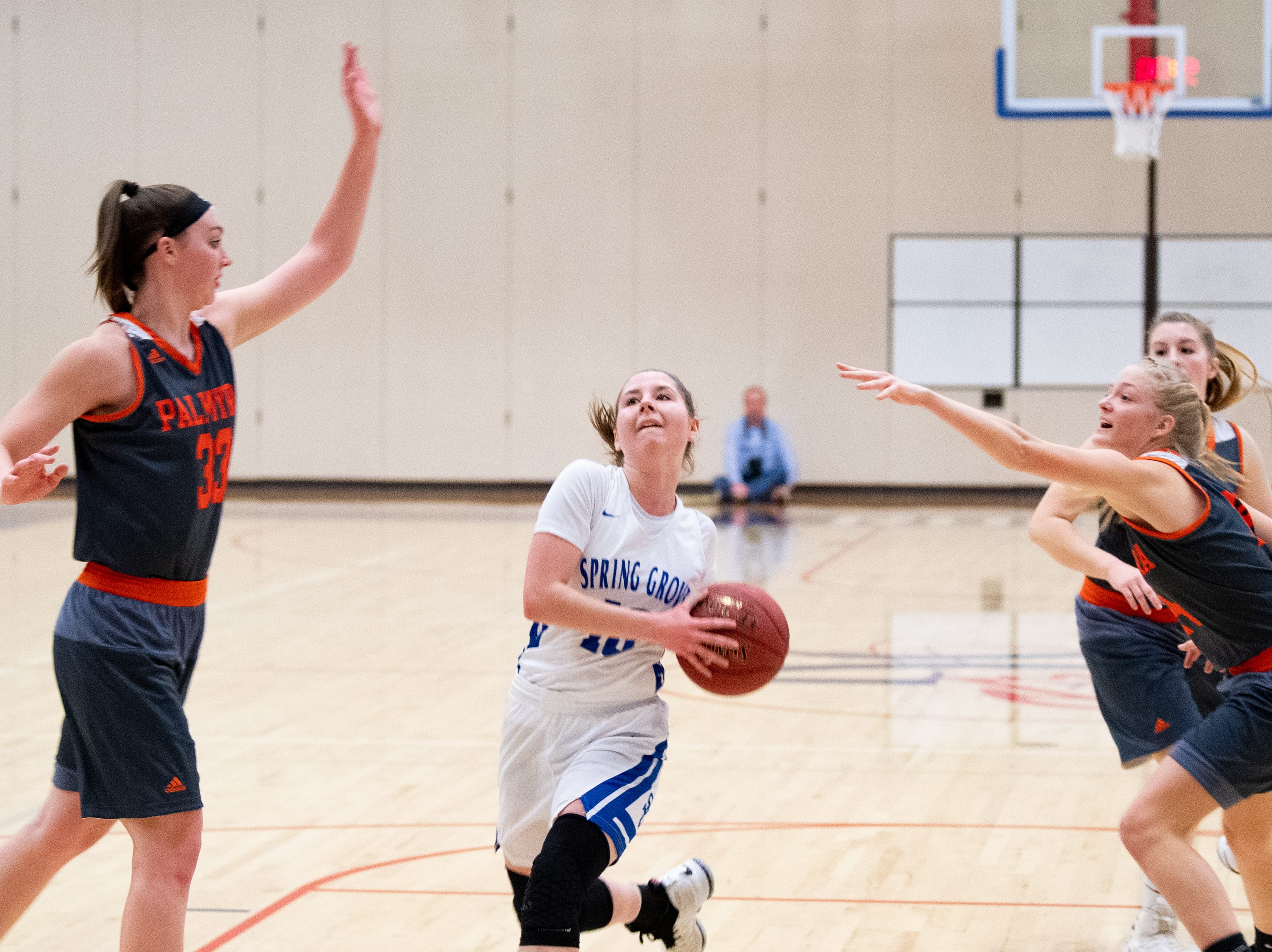 Ellie Glass (10) drives down the lane during the District 3 Class 5A girls' basketball quarterfinal between Spring Grove and Palmyra, Friday, February 22, 2019 at Spring Grove Area High School. The Cougars defeated the Rockets 43 to 41.