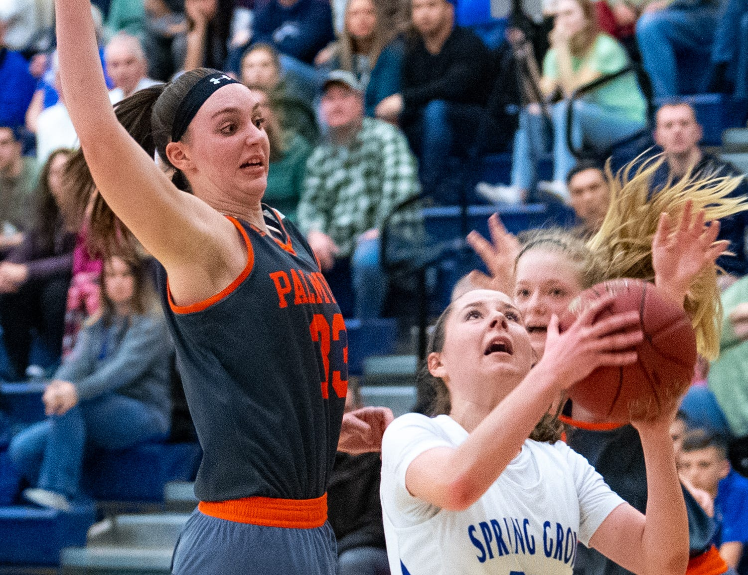 Olivia Richardson (33) of Palmyra looks to block Spring Grove's Ellie Glass (10) during the District 3 Class 5A girls' basketball quarterfinal between Spring Grove and Palmyra, Friday, February 22, 2019 at Spring Grove Area High School. The Cougars defeated the Rockets 43 to 41.
