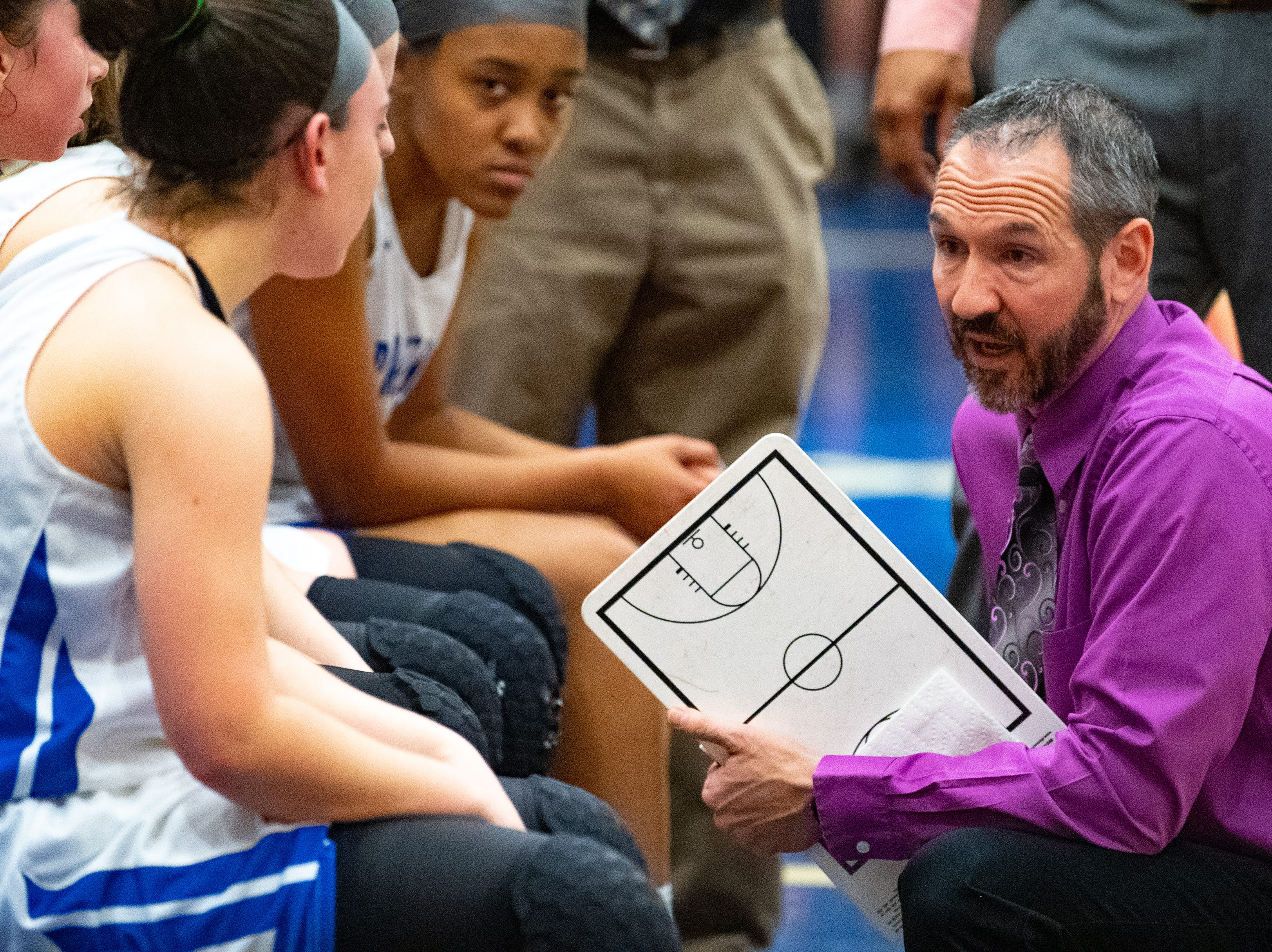 Spring Grove head coach Troy Sowers gives his team advice during a timeout in the District 3 Class 5A girls' basketball quarterfinal between Spring Grove and Palmyra, Friday, February 22, 2019 at Spring Grove Area High School. The Cougars defeated the Rockets 43 to 41.