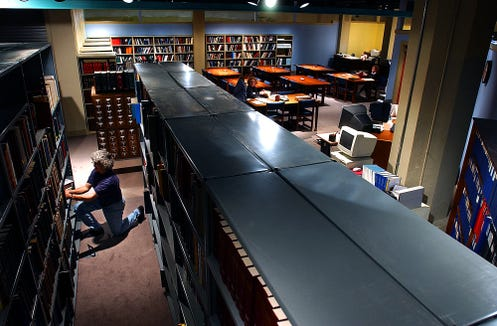 In a file photo from 2003, then York County Heritage Trust assistant librarian and archivist Lila Fourhman-Shaull refiles books in the expanded library . The 25-year York  County Center archivist died on Feb. 23 after a lengthy illness.