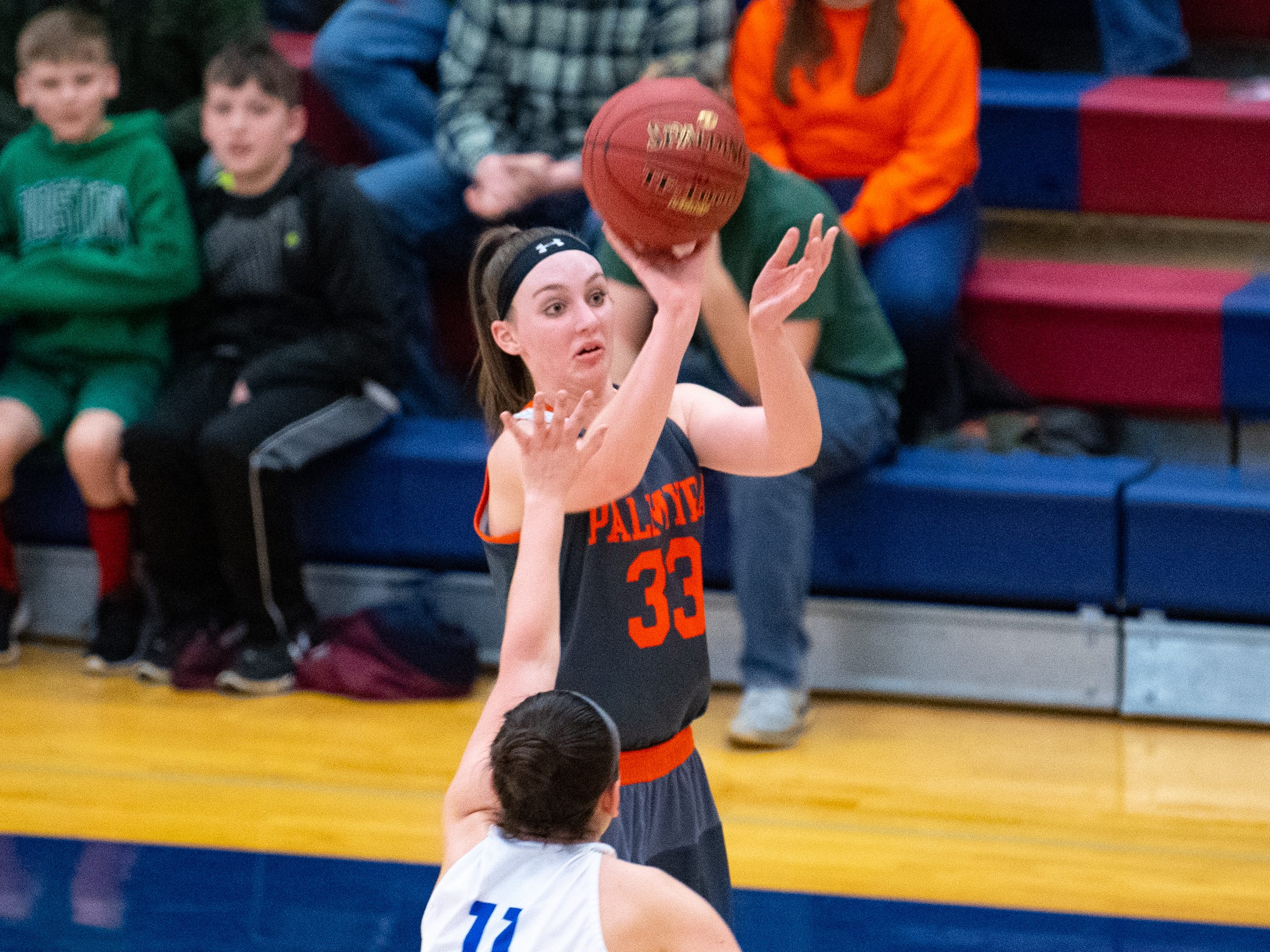 Olivia Richardson (33) shoots a three pointer during the District 3 Class 5A girls' basketball quarterfinal between Spring Grove and Palmyra, Friday, February 22, 2019 at Spring Grove Area High School. The Cougars defeated the Rockets 43 to 41.