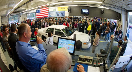 In this file photo from 2012, auto auctioneer Brian Gilbert speaks to a crowd.