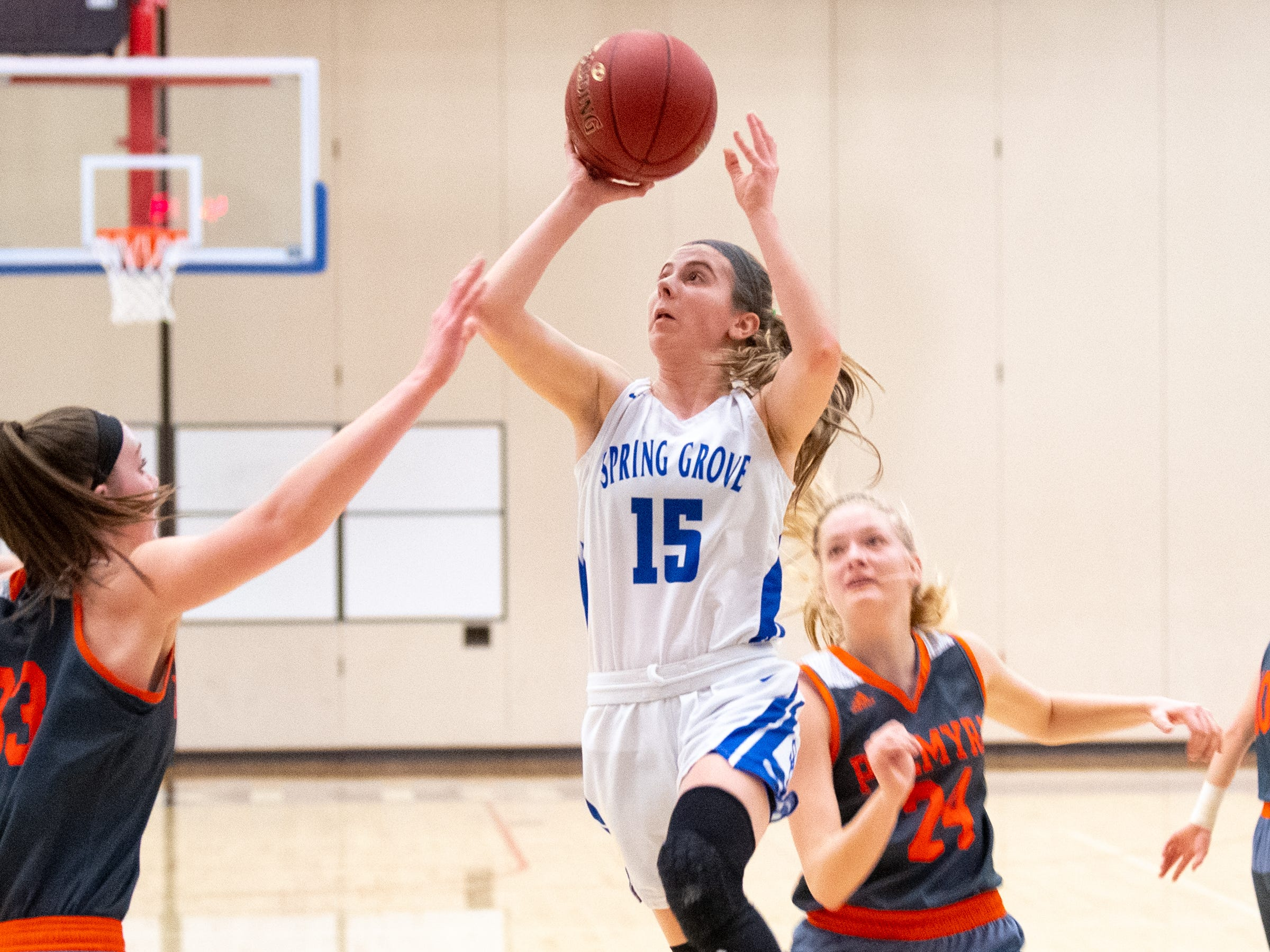 Lexi Hoffman (15) rises up during the District 3 Class 5A girls' basketball quarterfinal between Spring Grove and Palmyra, Friday, February 22, 2019 at Spring Grove Area High School. The Cougars defeated the Rockets 43 to 41.