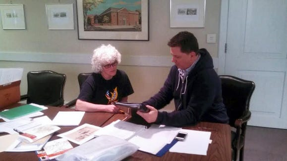 Journalist and historian Ted Sickler works with York County Heritage Trust's Lila Fourhman-Shaull on an upcoming book about people drawn by 19th-century York artist Lewis Miller in this York Daily Record file photo.
