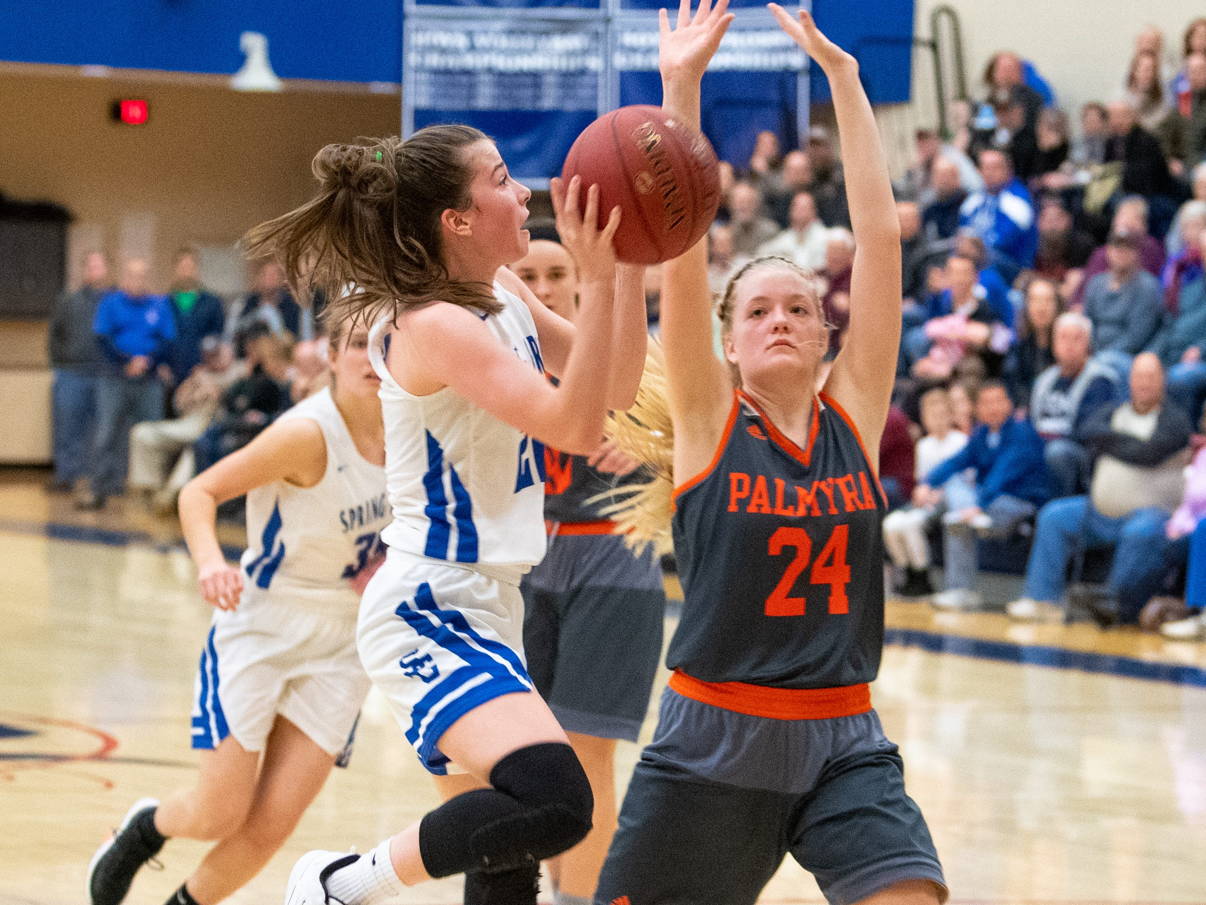 Ella Kale (22) takes the contested shot during the District 3 Class 5A girls' basketball quarterfinal between Spring Grove and Palmyra, Friday, February 22, 2019 at Spring Grove Area High School. The Cougars defeated the Rockets 43 to 41.