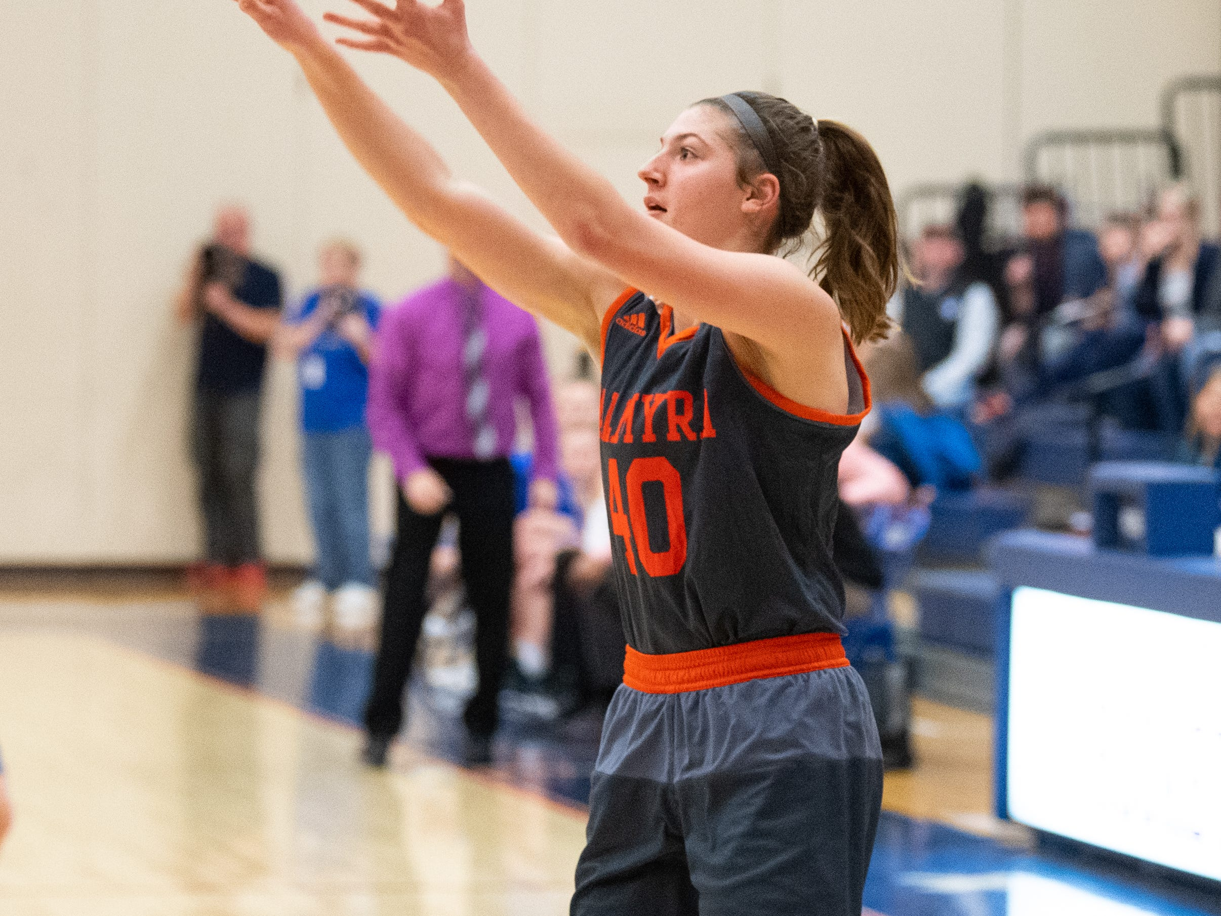 Katelyn Becker (40) shoots a jump shot during the District 3 Class 5A girls' basketball quarterfinal between Spring Grove and Palmyra, Friday, February 22, 2019 at Spring Grove Area High School. The Cougars defeated the Rockets 43 to 41.