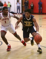 UPrep's Jakhi Lucas (15) is defended by Hilton's Tah'Jae Hill.