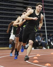 Rush-Henrietta's Ben Hulbert wins the boys 600 meter run with a time of 1:23.19 during the Section V Winter Track & Field Meet of Champions held at RIT, Friday, Feb. 22, 2019.