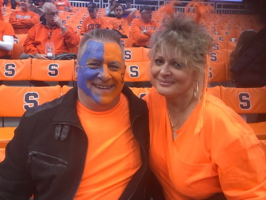 """Mark Barton, 60, left and Denie Shafer, 51, of Sloansville, Schoharie County at Saturday's Syracuse vs. Duke game. Their hearts were with Jim Boeheim, who was coaching after accident that claimed the life of a man earlier in the week. """"We do feel for him, and sad that something like that can happen, but accidents happen and it was an accident,'' Barton said."""