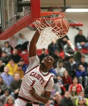 Hilton's Tah'Jae Hill goes in for a dunk against UPrep in a Class AA Sectional game.