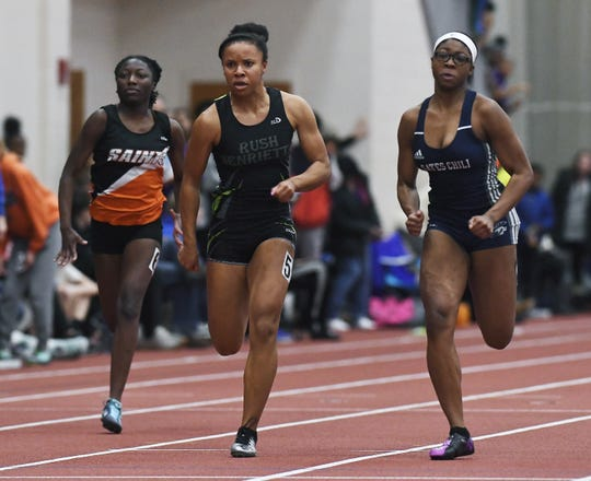 Rush-Henrietta's Jaelyn Davis, center, outkicks Gates-Chili's Indya Richards, right, to win the girls 55 meter dash during the Section V Winter Track & Field Meet of Champions held at RIT, Friday, Feb. 22, 2019.