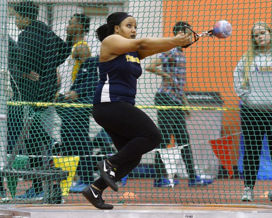 Webster Thomas' Monique Hardy wins the girls weight throw with a distance of 62-8.50 during the Section V Winter Track & Field Meet of Champions held at RIT, Friday, Feb. 22, 2019.