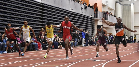 Wilson's Jahkier Moore, center, wins the boys 55 meter dash with a time of 6.48 during the Section V Winter Track & Field Meet of Champions held at RIT, Friday, Feb. 22, 2019.