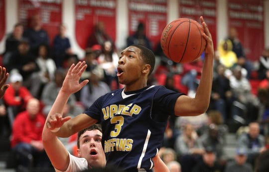 UPrep's Kayshawn Ross drives to the basket against Hilton's Mitchell Carr.