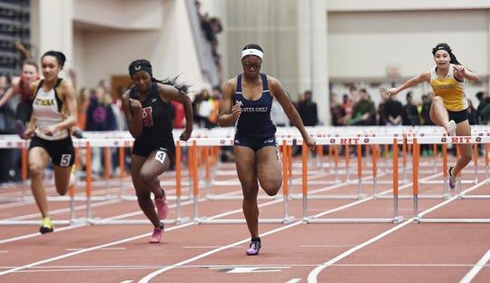 Gates-Chili's Indya Richards wins the girls 55 meter hurdles  with a time of 8.10 during the Section V Winter Track & Field Meet of Champions held at RIT, Friday, Feb. 22, 2019.