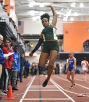 Greece Olympia's Jayda Singleton wins the girls long jump with a distance of 19-04.75 feet during the Section V Winter Track & Field Meet of Champions held at RIT, Friday, Feb. 22, 2019.