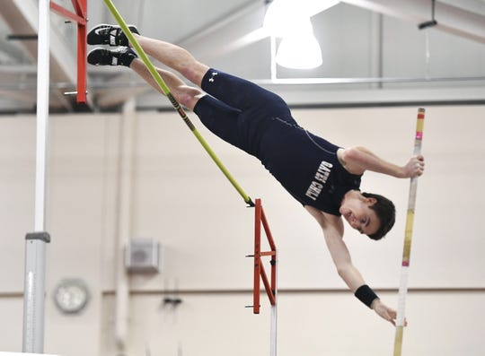 Gates-Chili's Dustin Meyer clears a height of 15-09.00 feet to win the boys pole vault during the Section V Winter Track & Field Meet of Champions held at RIT, Friday, Feb. 22, 2019.