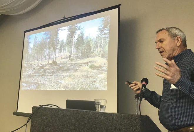 Tim Tate, the southern-area manager for Sierra Pacific Industries, speaks Saturday at the California Society of American Foresters meeting in Folsom. Tate described the shaded fuel breaks his company is doing.