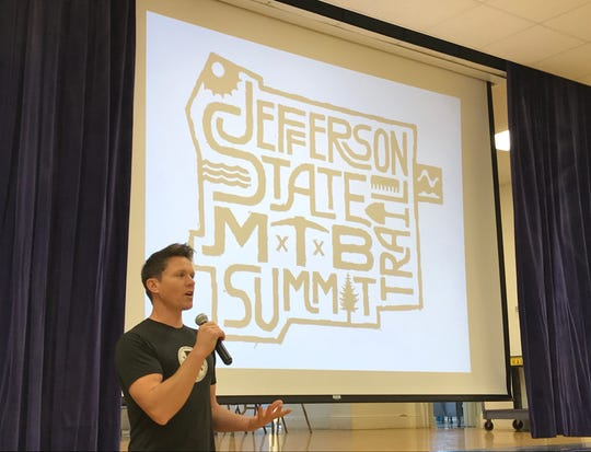 Nathan Knudsen of the Redding Trail Alliance speaks Saturday to open the first Jefferson State MTB Summit at the Veterans Memorial Building in Redding.