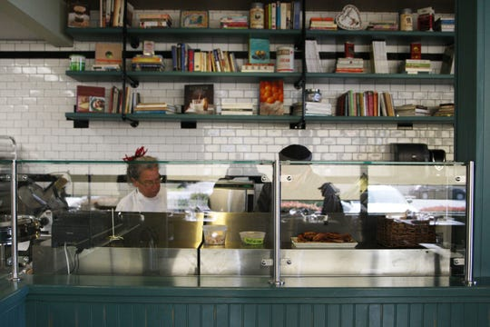 Staff works behind the counter at Wild Thyme.