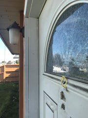 One of the bullets shot at Rahali hit and shattered the window at the top of his front door.