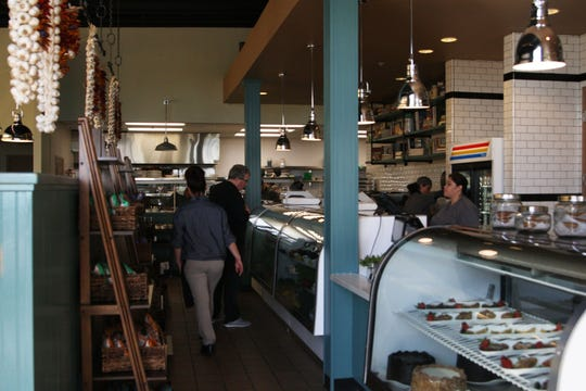 Patrons and staff bustle around the deli at Wild Thyme.
