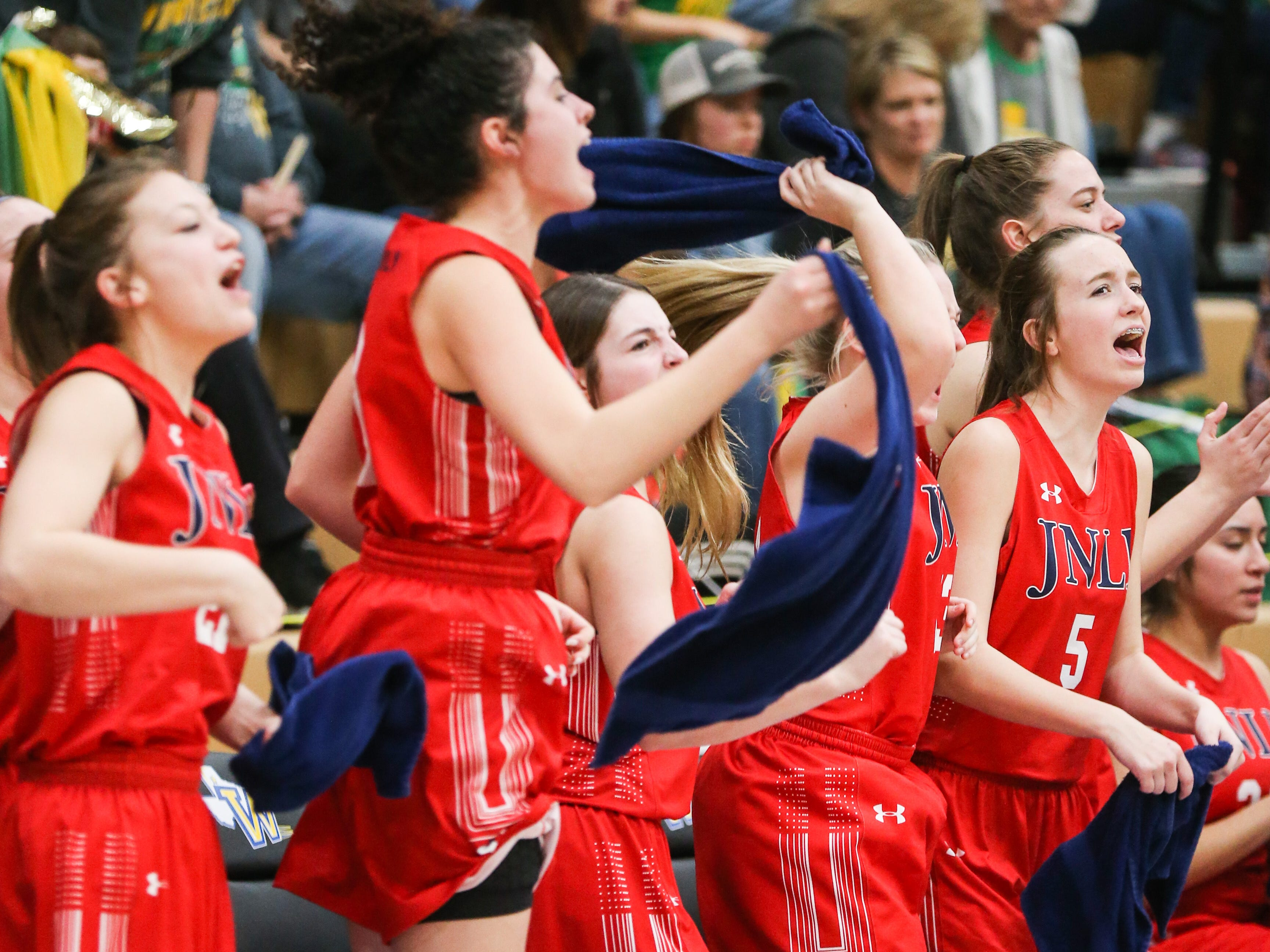 Jim Ned players cheer on their team during the I-3A regional tournament against Idalou Friday, Feb. 22, 2019, at Wayland Baptist University in Plainview.