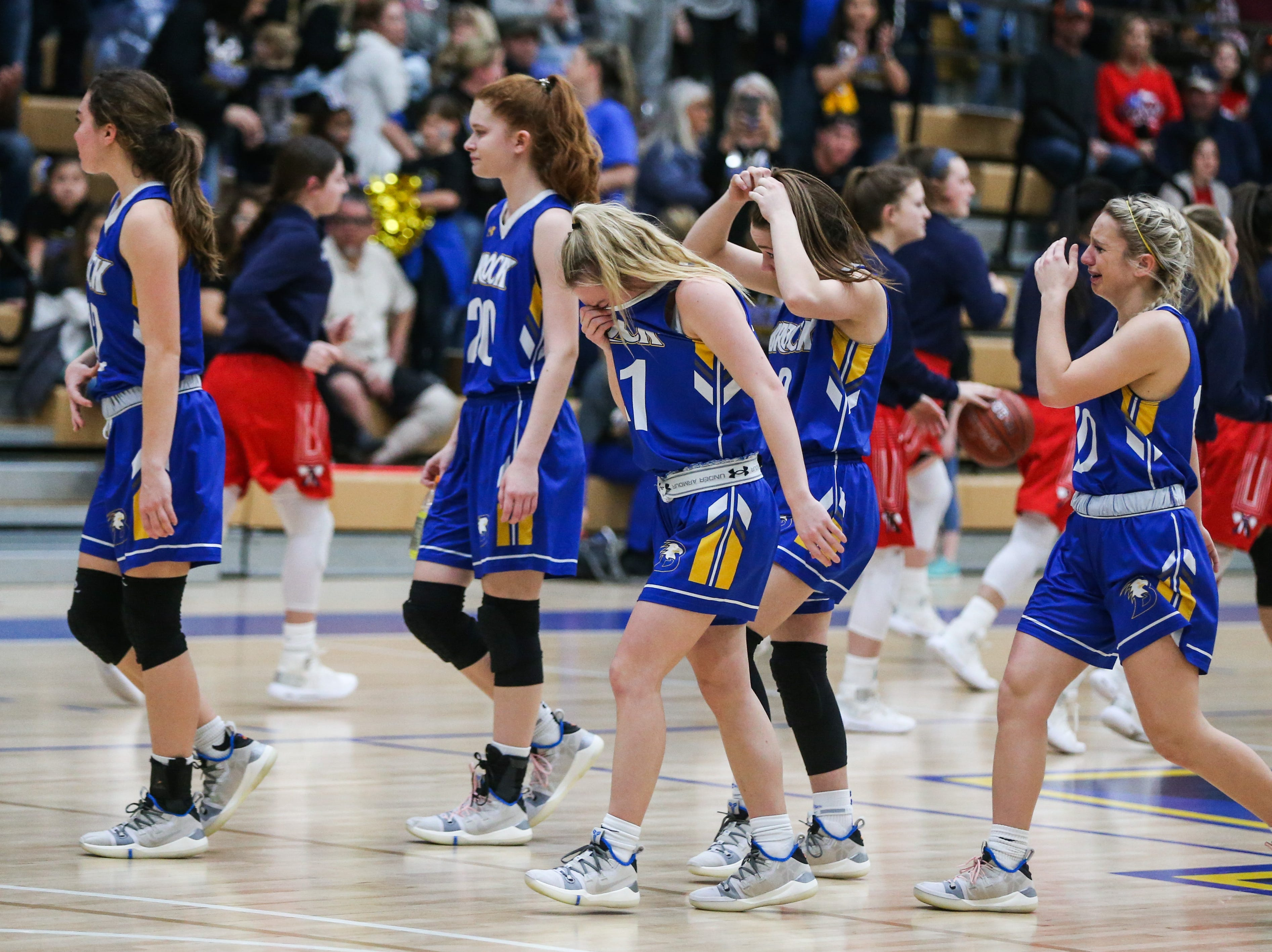 Brock players leave the court after during the I-3A regional tournament against Wall Friday, Feb. 22, 2019, at Wayland Baptist University in Plainview.