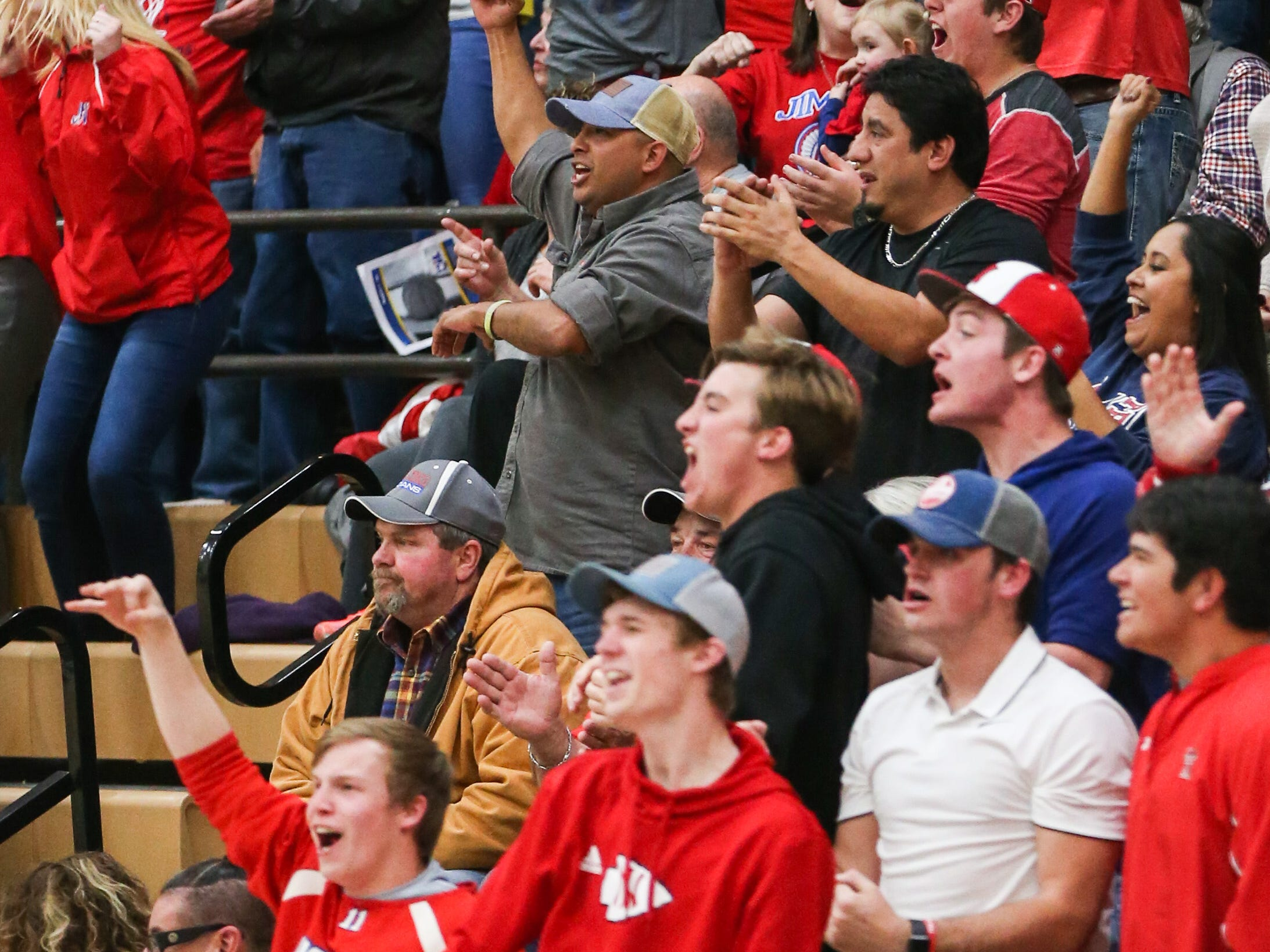 Jim Ned fans cheer on their team during the I-3A regional tournament against Idalou Friday, Feb. 22, 2019, at Wayland Baptist University in Plainview.
