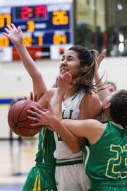Wall's Samantha Rocha is fouled by Idalou's Shaylee Stovall during the I-3A regional finals Saturday, Feb. 23, 2019, at Wayland Baptist University in Plainview.