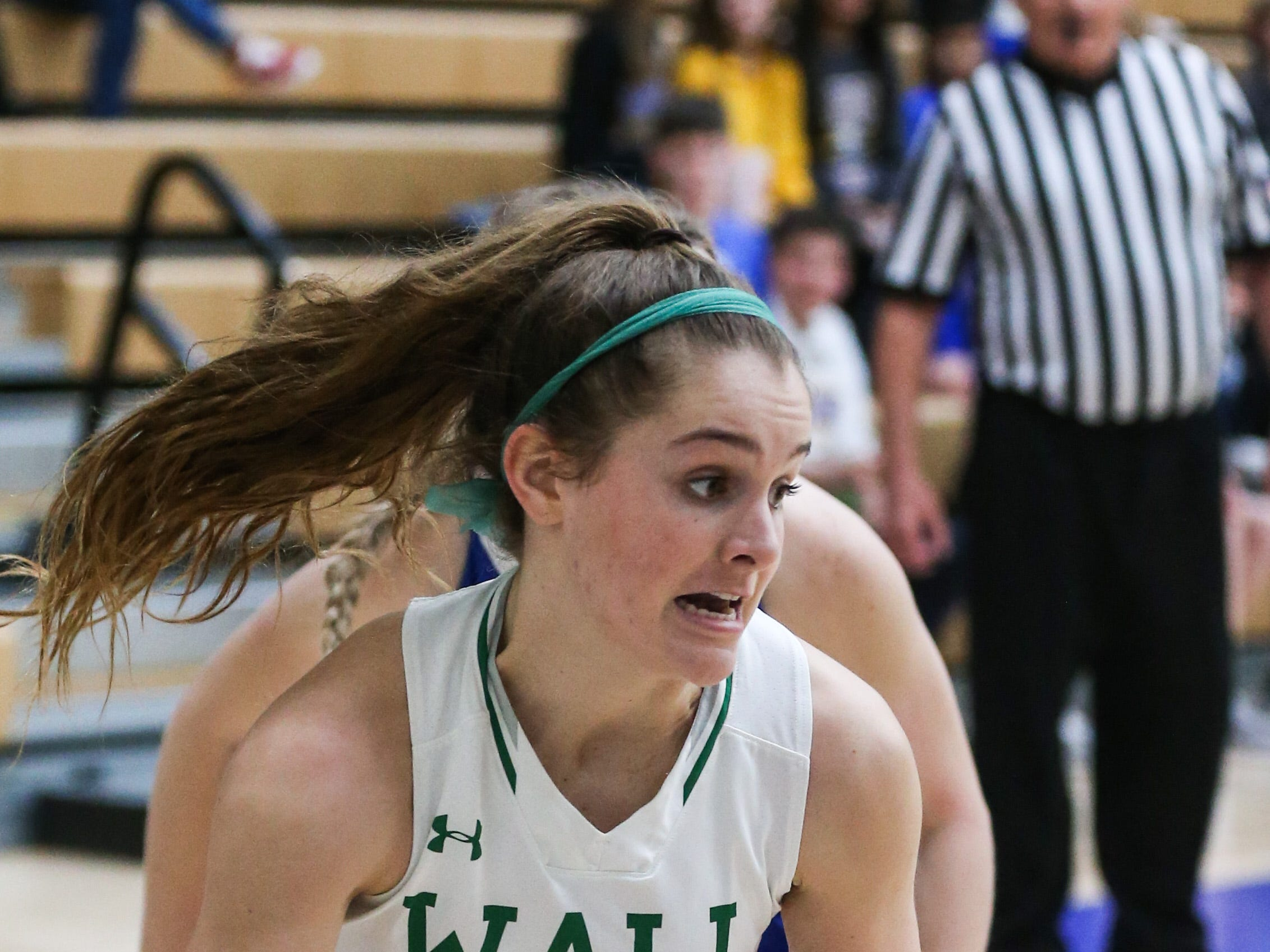 Wall's Kylie Phillips dribbles around Brock during the 1-3A regional tournament Friday, Feb. 22, 2019, at Wayland Baptist University in Plainview.