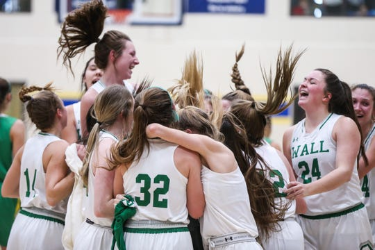 Wall girls group hug as they win the I-3A regional finals against Idalou Saturday, Feb. 23, 2019, at Wayland Baptist University in Plainview.